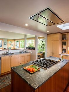 Flush ceiling mount range hood a great alternative for open space over an island cook top.