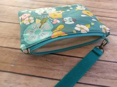 Floral WristletClutch BagTeal Waxed Canvas by ditsybritishcraft