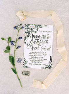Floral inspired calligraphy invites: http://www.stylemepretty.com/new-york-weddings/2016/01/08/whimsical-woodland-wedding-in-the-catskills/ | Photography: Karen Hill - http://www.karenhill.com/