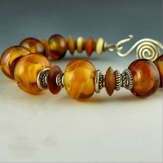 Items similar to handmade bracelet bangle lampwork beads sterling silver natural bone - Sparkling Amber Bangle on Etsy Handmade Bracelets, Bangle Bracelets, Bangles, Lampwork Beads, Fashion Bracelets, Sterling Silver Rings, Beaded Jewelry, Glass Beads, Amber