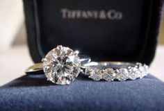 Tiffany Engagement Ring...WHOA that rock is huge! Love the setting, but (I can't believe I'm saying this) a smaller size and a solid band instead of all the bling would look much daintier on my finger :)