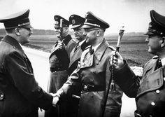 Adolf Hitler shakes hands with Heinrich Himmler. Germany, May 18, 1944.  Also present, from left to right, Generalfeldmarschall Wilhelm Keitel, Großadmiral Karl Dönitz and Generalfeldmarschall Erhard Milch.