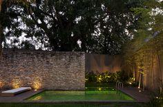 casa terra nova, são paulo  stone wall  idea for Tropico