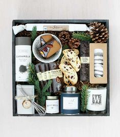 In this gorgeous charcoal crate, we feature a caddy of bellocq herbal tea, Best Bees local honey, Byrne & Carlson chocolate, and a buttery log of Suss caramel: 'Our Favorite Things' by Winston Flowers.