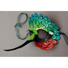 Made my own cheap version of this. Like how it looks. Used feathers, a craft Mask, and cardstock. The colors on this creative Hummingbird mask are gorgeous annnnd appropriate!