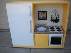 Another play kitchen we made out of an old entertainment center.