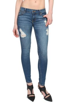TheMogan Women's Stunner Ankle Slit Distressed Skinny Jeans Medium 3XL. Low rise ; Fitted through skinny legs with ankle slits. Fade wash with destroyed detailing. Five pocket styling. Stretch for comfort. 73% cotton 14% rayon 11% polyester 2% spandex.