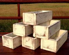 This listing is for one set of 10 distressed wood boxes. The options are endless for these wood boxes. The boxes make a great addition to a rustic wedding or barn wedding when used as a table centerpiece. Turn the boxes upside down and use them as a riser to change elevation for a centerpiece. No matter how used, these simple distressed wood boxes will add character to your decor. Dimensions of wood box shown are 12L x 4-3/4W x 3-1/2H. This distressed wood box will accommodate up to...