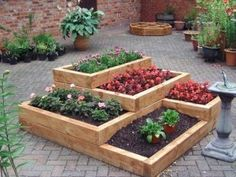 Tiered garden. Make it circular and build it out of stone and dirt instead (retaining walls).