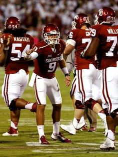 Oklahoma's Trevor Knight (9) congratulates teammates after a play during a college football game between the University of Oklahoma Sooners (OU) and the Tennessee Volunteers at Gaylord Family-Oklahoma Memorial Stadium in Norman, Okla., on Saturday, Sept. 13, 2014. Photo by Steve Sisney, The Oklahoman