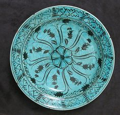 Dish Date: 16th–17th century Geography: Iran Culture: Islamic Medium: Stonepaste; painted in black under turquoise glaze Dimensions: D. 13 1...