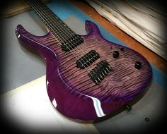 Kiesel Guitars Carvin Guitars AM7 (Aries Multiscale) Deep purple caliburst over flamed maple top on mahoigany body with Kiesel Lithium pick ups and Hipshot Bridge