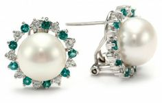 White Freshwater Cultured Pearl earrings. Gemstones may have been treated to improve their appearance or durability and may require special care.