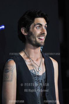"""tyson ritter has an outlet tattoo on his arm and the wire ''plugs into"""" his aar symbol on his chest"""