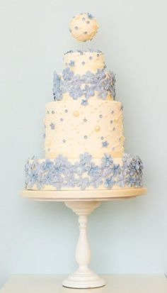 Love the blue on white and would use something prettier on top as an ornament or a bouquet of blue/violet flowers sunk in a glass in the top layer.