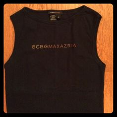 BCBG MaxAzria Cotton Logo Muscle Tank. 100% Cotton Sophisticated and simple; BCBG Max Azria logo muscle tank in 100% soft cotton. Made in the USA. Black tank perfectly sets off the designers logo. Wear this tank under a cardigan or jacket for a perfect designer touch, or dress up your workout wardrobe with this classic, refined tank. Worn once. In great shape. BCBGMaxAzria Tops Tank Tops