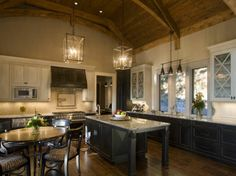Dark and light wood cabinetry, wood beams and lots of texture... Beverly Hanks