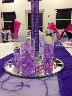 Purple wedding centerpiece. Tablescaping.
