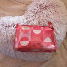 Pink Lancôme Makeup Bag  Pink Lancôme Makeup Bag. Small size and has a clear pocket in the front. A little dirty on the bottom, but can probably be easily cleaned with a little TLC. Used; great condition. Lancome Bags Cosmetic Bags & Cases