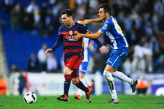 Lionel Messi of FC Barcelona competes for the ball with Jose Jordan of RCD Espanyol the Copa del Rey Round of 16 second leg match between RCD Espanyol and FC Barcelona at the Power8 stadium on January 13, 2016 in Barcelona, Catalonia.