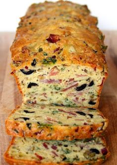 Susan Recipe: Culinary Arts: Olive, Bacon and Cheese Bread-5 fl oz (15cl) of white wine 3 1/3 fl oz (10cl) olive oil 4 eggs 1/2 teaspoon salt 2 1/2 cup (250g) all purpose flour 1 teaspoon of baking powder (about 5g) 5 ounces (150g) grated swiss cheese or cheddar 1 large onion 3 1/2 ounces (100g) bacon 7 ounces (200g) city ham-360-1 hr.