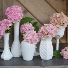 Cute idea for any party/tea table. I know we all have loads of these single stem vases hidden in our cabinets. Use them!