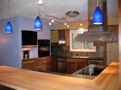 Open concept kitchen with pendant lighting