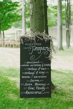Chalkboard wedding ceremony program - the baby's breath looking stuff on top