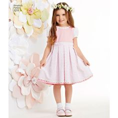 These decorative dresses for children and girls can be made in two lengths. They feature a variety of fabric and trim options so you can create the perfect dress for any occasion. Simplicity sewing pattern.