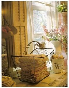 Wire basket for hand towels - would be great for guest bath