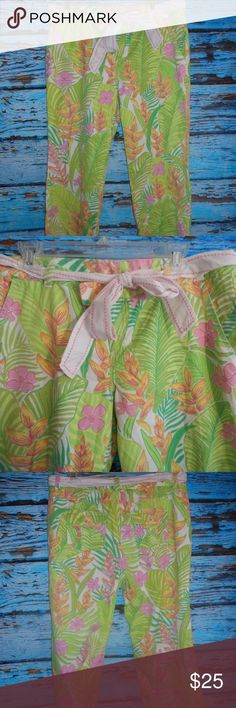 """Lilly Pulitzer Floral Ankle Pants These are in very good condition. From the waist to the bottom of the pants measures approximately 32"""". The inseam measures approximately 23"""". Lilly Pulitzer Pants"""