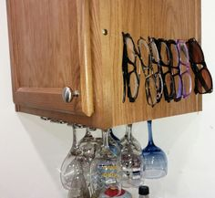 A couple of upholstery tacks and some fishing line got those glasses up off of the counter.