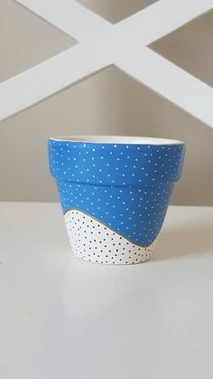Check out this item in my Etsy shop https://www.etsy.com/uk/listing/602281987/small-hand-painted-flower-pot-blue-with