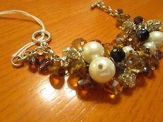 clear/black/gold/white shell glass beads in bunch up pattern bracelet.
