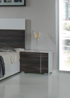 "Nova Domus Corrado Italian Modern White & Grey Nightstand. The Nova Domus Corrado Italian Modern White & Grey Nightstand features a sleek white gloss and matte grey finish with stainless steel accents on either the right or left side. It comes with 2 self-closing drawers and stands on square stainless steel feet. Measuring W27"" x D16"" x H21"", this made in Italy modern nightstand requires no assembly. Dimensions: W27"" x D16"" x H21"" Color: White Finish:  Glossy -"