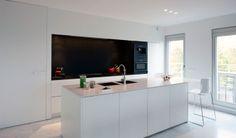 All White Kitchen With A Black Niche. Schelde Apartement By Aerts+Blower.