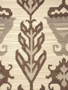 Brown-Ivory Hand Woven Vintage Kilim   This kilim is a traditional handmade flatweave rug. The earth tone color palette and refined, simplified designs represent generations of passed-down traditions. Hand made from wool, this rug is constructed using the flat-weave technique that gives it a delicate thinness.