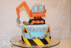 Children's Birthday Cakes - construction zone cake for my son. all edible. the challenge was to build an excavator that the plow could stay up in the air... made it with gumpaste and a good edible glue ; )