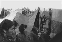 Armenian Deportees: 1915-1916 Caption: 1915, Armenian deportees in a camp of makeshift tents inhabited mostly by women and children in barren desert. Location: Ottoman empire, region Syria.