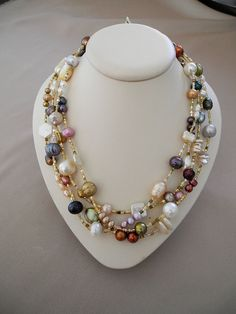 A 67 inch necklace of pearls in a variety of colors, shapes and sizes. It can be worn in a variety of ways from long and doubled to a four strand necklace. The clasp is a gold filled lobster claw. Pearl Jewelry, Wire Jewelry, Jewelry Crafts, Beaded Jewelry, Jewelery, Vintage Jewelry, Jewelry Necklaces, Handmade Jewelry, Pearl Necklace