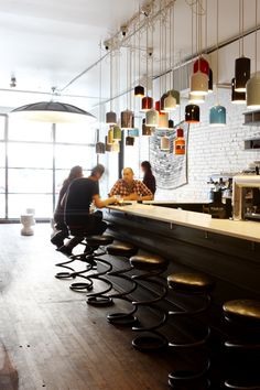 Controversy in Toronto: Parts & Labour Restaurant & Club Remodelista     - Look at this restaurant!  The stools are made from industrial springs, and I love the mess of cord showing for the light fixture.