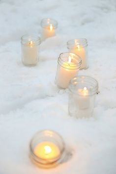 you can't get anymore simple than this...my favorite so far....fake snow on the tables...different size mason jars with white lit candles....LOVE IT!  favors......snow shaped cookies made with love by you!