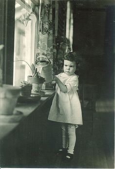 Adorable! Soooo intent she is to water Momma's plants with that heavy watering can.  Check out her stocking grips. bnp