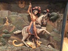 St.George slaying the Dragon. Polychrome Wood Carving, 16th Century; probably either Rhineland or Spanish. Displayed in a box 105 cms x 93 cms.  An exceptional thing.  POA