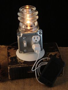 Upcycled Glass Insulator Lamp with Outlet for Phone Charging.