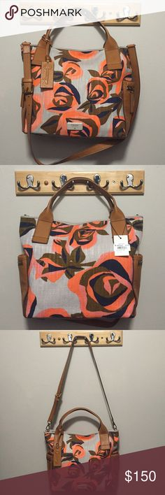 Fossil Emerson Floral Satchel 100% Authentic fossil handbag in beautiful floral and leather trim. Zipper top, outside pockets, 1 inside zip pocket and 2 open pockets. Two handles and One adjustable strap. Fossil Bags Satchels