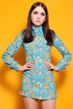 Late 60s mini dress. It's my hairstyle from 1969-70!