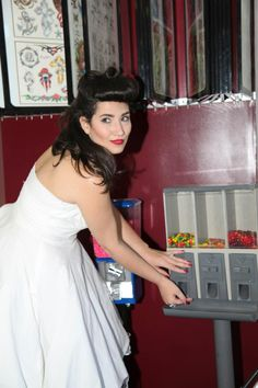 White, swing dress at vintage candy machine at Wicked Ink Tattoo Parlor  |  Photographer:  LAURIE BRANDT of LAURIE BRANDT PHOTOGRAPHY www.lauriebrandt.zenfolio.com  |  Makeup:  JESSICA PULEO of COSMIC MAKEUP www.cosmicmakeup.com  |  Hair:  CASSANDRA FALCONE HAIR ARTIST www.cf-hair.com