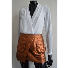 Crackled Metallic Skirt! Brand new with tag! Shell: 100% Polyester. Lining: 100% Polyester. Short skirt with a crackled metallic finish. Slightly asymmetrical, attached wrapover section at front, bellow pockets with flap, & visible zip & snap fastener at back. Lined. No Trades No Paypal Yes, bundles✔️ I DO NOT EXCEPT ANY LOW BALL OFFERS!  Follow me on Instagram: ashleyjcloset  H&M Skirts