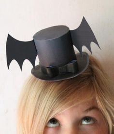 Mini Bat wing paper top hat for Halloween! DIY printable templates here: happythought.co.uk/product/halloween-mini-top-hats